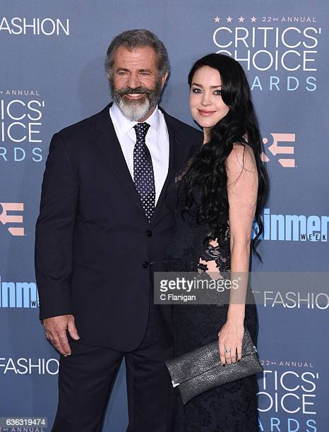 Actorfilmmaker Mel Gibson and actress Rosalind Ross arrive at The 22nd Annual Critics' Choice Awards at Barker Hangar on December 11 2016 in Santa...