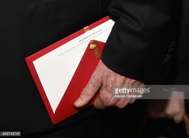 Actor/filmmaker Warren Beatty holds the envelope containing the wrong award announcement for Best Picture during the 89th Annual Academy Awards...