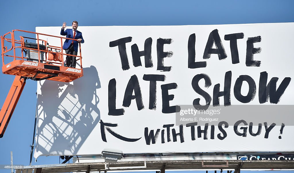 Actor/host <a gi-track='captionPersonalityLinkClicked' href=/galleries/search?phrase=James+Corden&family=editorial&specificpeople=673860 ng-click='$event.stopPropagation()'>James Corden</a> puts up his own billboard for CBS Television Network's 'The Late Late Show' on March 6, 2015 in Los Angeles, California.