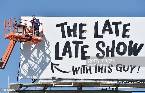 Actor/host James Corden puts up his own billboard for CBS Television Network's 'The Late Late Show' on March 6 2015 in Los Angeles California