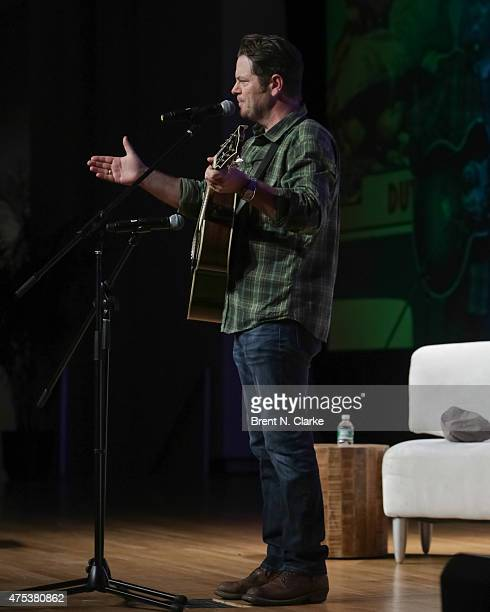 Actor/humorist Nick Offerman performs on stage during 'Nick Offerman's Gumption Revival' at BookCon held at the Javits Center on May 30 2015 in New...