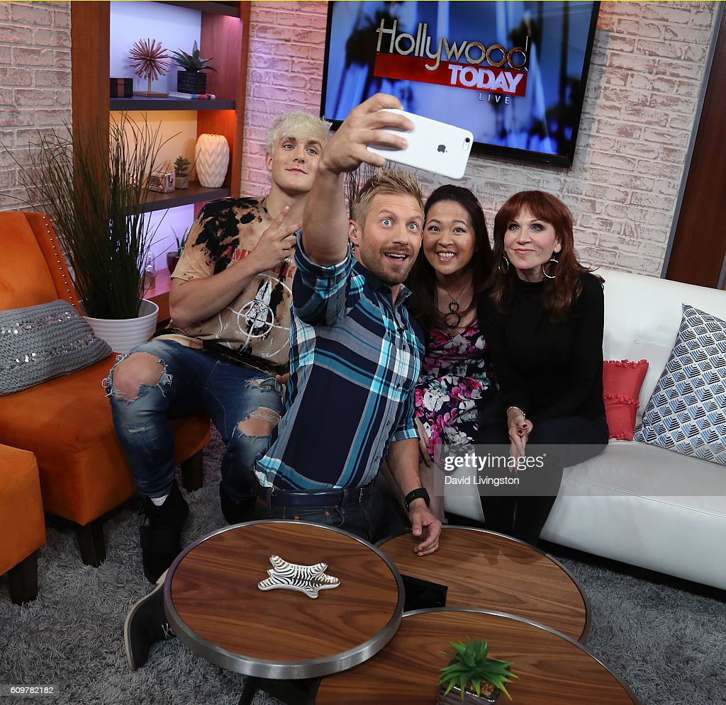Actor/internet personality Jake Paul, host Tanner Thomason and actresses Suzy Nakamura and Marilu Henner pose for a selfie at Hollywood Today Live at W Hollywood on September 22, 2016 in Hollywood, California.