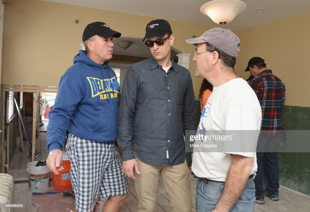 Actor<a gi-track='captionPersonalityLinkClicked' href=/galleries/search?phrase=Josh+Charles&family=editorial&specificpeople=240614 ng-click='$event.stopPropagation()'>Josh Charles</a> (C) helps repair a home as The Cast Of 'The Good Wife' Celebrates Their100th Episode With A Day Of Service For The St. Bernard Projecton on October 26, 2013 in New York City.