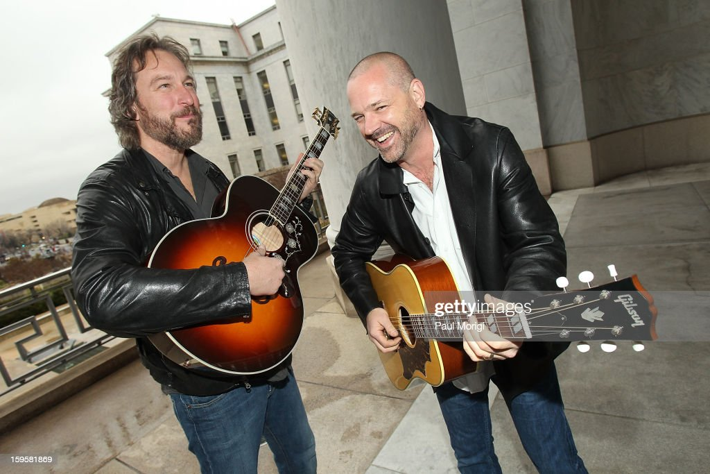 Actor/musician <a gi-track='captionPersonalityLinkClicked' href=/galleries/search?phrase=John+Corbett&family=editorial&specificpeople=221714 ng-click='$event.stopPropagation()'>John Corbett</a> (L), playing a Gibson Country Western guitar, and Grammy-winning/songwriter/producer J.R. Stewart, playing a Gibson J200 guitar, perform at a musical briefing and Welcome Back to Congress Event presented by The Recording Academy's 'Grammys on the Hill' at U.S. House of Representatives on January 16, 2013 in Washington, DC.