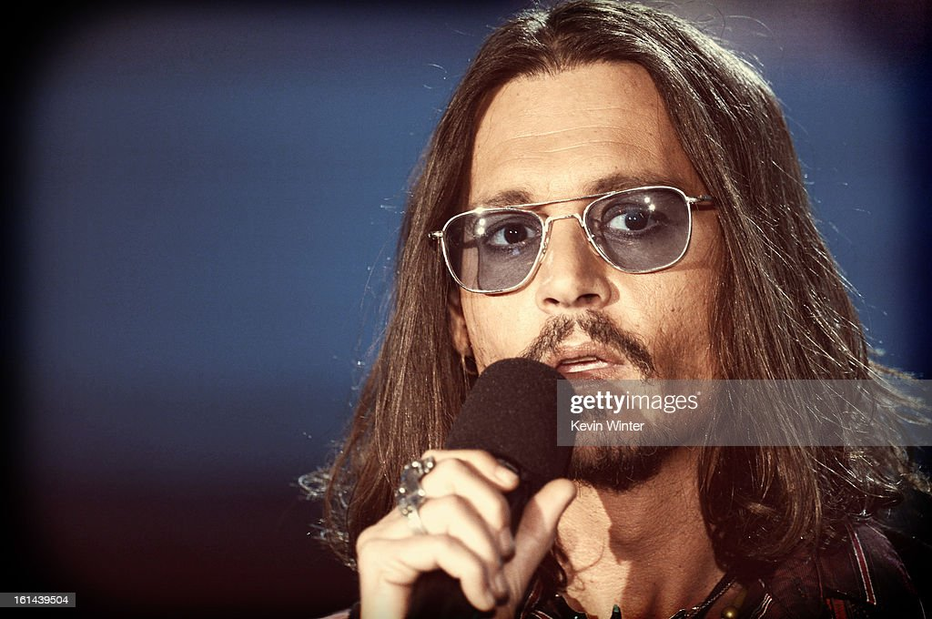 Actor/musician <a gi-track='captionPersonalityLinkClicked' href=/galleries/search?phrase=Johnny+Depp&family=editorial&specificpeople=202150 ng-click='$event.stopPropagation()'>Johnny Depp</a> speaks onstage during the 55th Annual GRAMMY Awards at STAPLES Center on February 10, 2013 in Los Angeles, California.