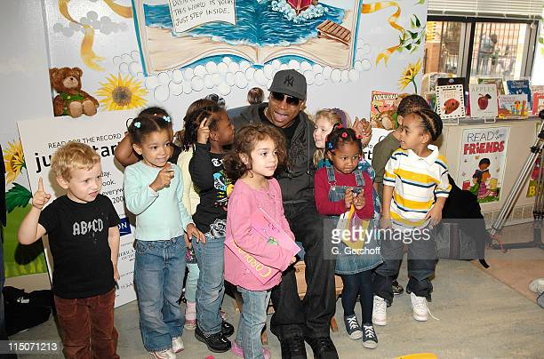 Actor/musician LL Cool J poses for pictures with children at the Jumpstart's Read for the Record at The Bank Street Head Start on October 2 2008 in...