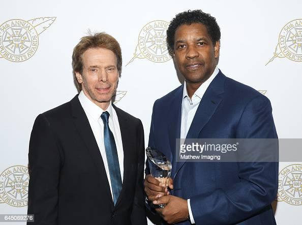 Actor/presenter Jerry Bruckheimer and actor/honoree Denzel Washington pose with Motion Picture Showman of The Year award at the 54th Annual ICG...