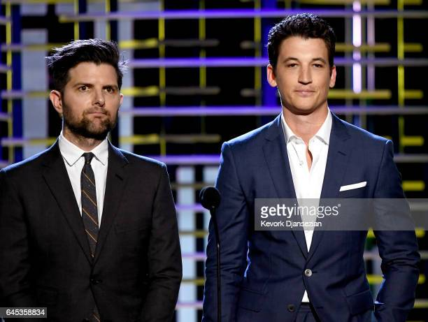 Actorproducer Adam Scott and actor Miles Teller speak onstage during the 2017 Film Independent Spirit Awards at the Santa Monica Pier on February 25...