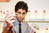 Actor/producer Adrian Grenier signs a chalice in support of Stella Artois and Waterorg's #buyaladyadrink campaign during '52 The Search for the...