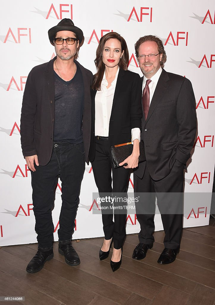 Actor/producer Brad Pitt, actress/director Angelina Jolie and AFI President and CEO Bob Gazzal attend the 15th Annual AFI Awards at Four Seasons Hotel Los Angeles at Beverly Hills on January 9, 2015 in Beverly Hills, California.