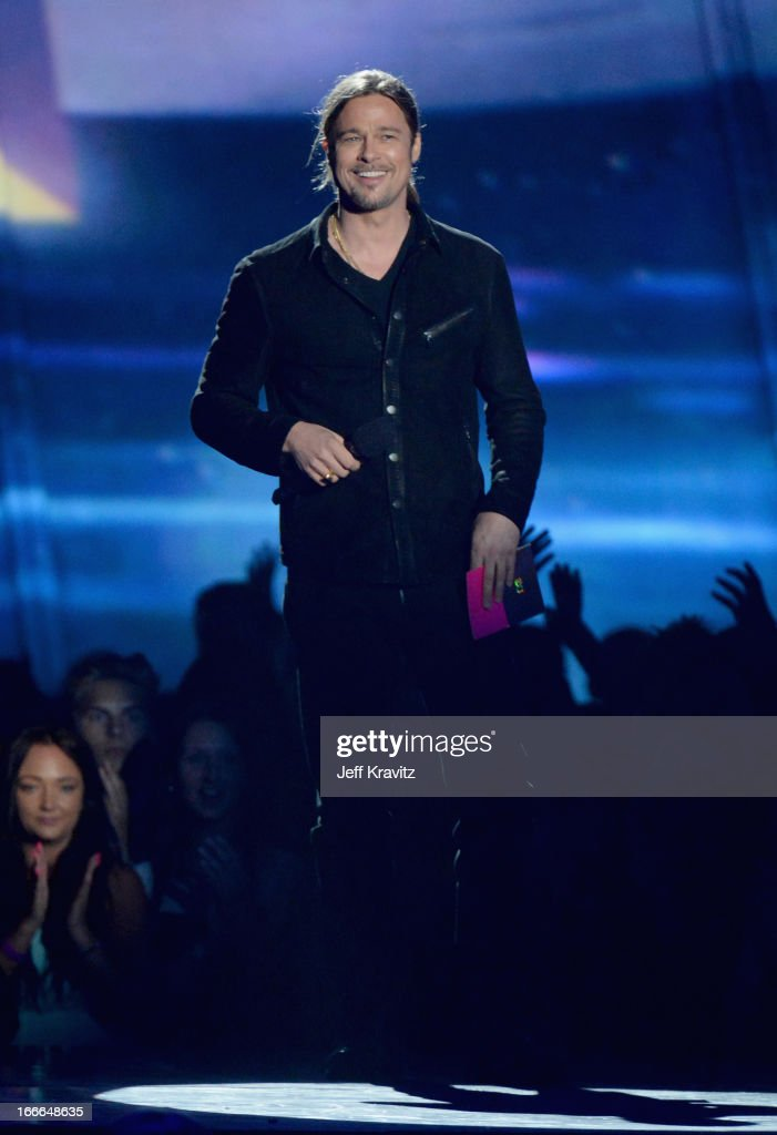 Actor/producer Brad Pitt speaks onstage during the 2013 MTV Movie Awards at Sony Pictures Studios on April 14, 2013 in Culver City, California.