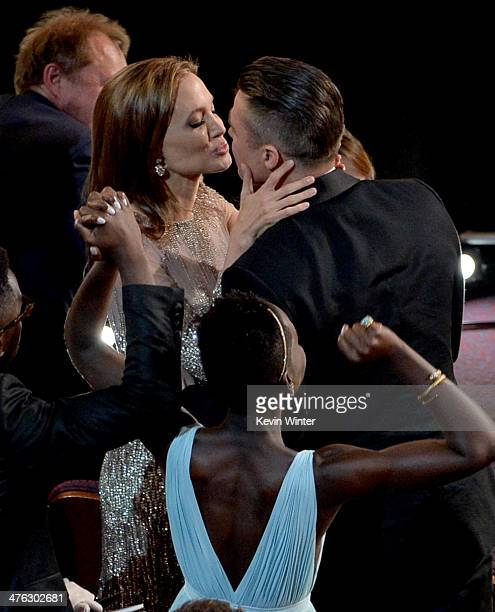Actor/producer Brad Pitt winner of the Best Picture award for '12 Years a Slave' with actress Angelina Jolie in the audience during the Oscars at the...