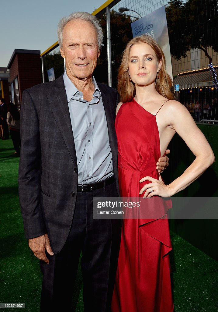 Actor/Producer Clint Eastwood (L) and actress Amy Adams arrive at the 'Trouble With The Curve' Premiere at Mann's Village Theatre on September 19, 2012 in Westwood, California.