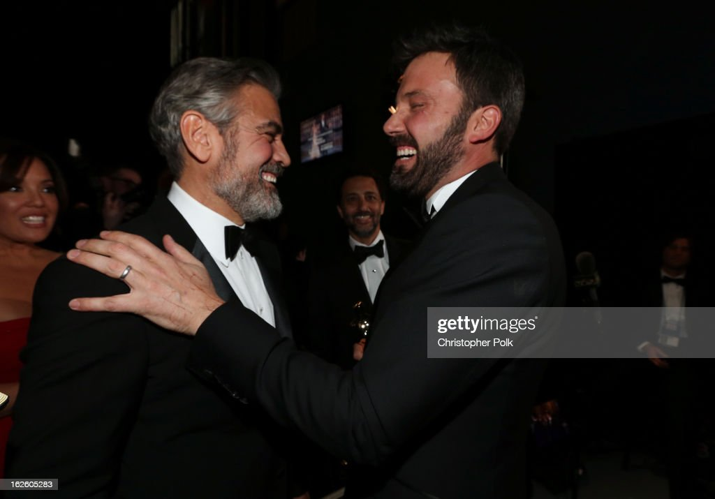 Actor/producer <a gi-track='captionPersonalityLinkClicked' href=/galleries/search?phrase=George+Clooney&family=editorial&specificpeople=202529 ng-click='$event.stopPropagation()'>George Clooney</a> (L) and actor/director <a gi-track='captionPersonalityLinkClicked' href=/galleries/search?phrase=Ben+Affleck&family=editorial&specificpeople=201856 ng-click='$event.stopPropagation()'>Ben Affleck</a> backstage during the Oscars held at the Dolby Theatre on February 24, 2013 in Hollywood, California.