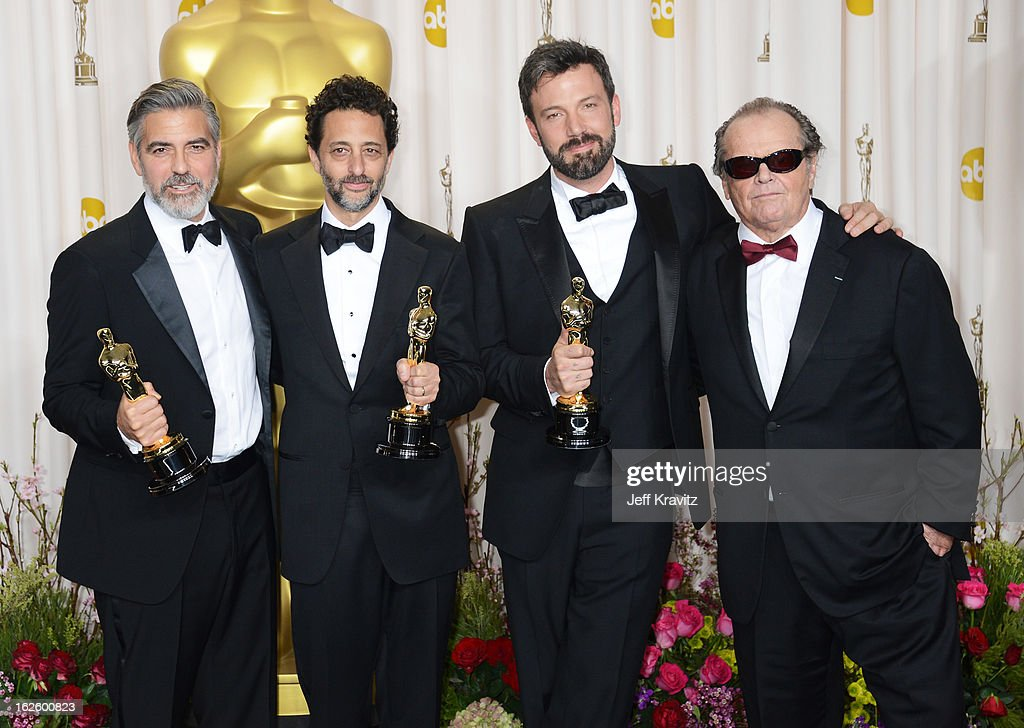 Actor/producer George Clooney producer Grant Heslov actor/producer Ben Affleck and actor Jack Nicholson pose in the press room during the Oscars at...