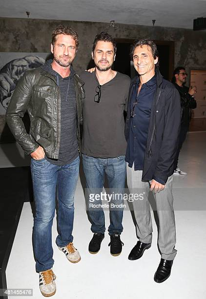 Actor/producer Gerard Butler director Ariel Vromen and producer Lawrence Bender attend the Paolo Troilo 'The Substance of Ideas' art exhibition at...