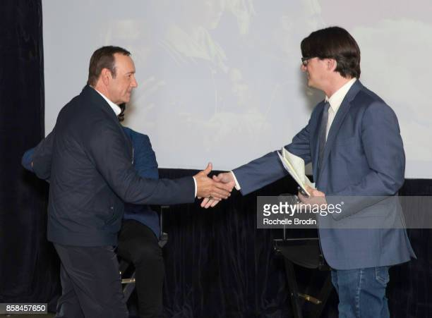 Actor/producer Kevin Spacey is greeted by LA Times reporter Mark Olsen at the Cars Arts Beats A Night Out With 'Baby Driver' panel discussion at the...