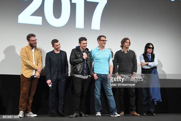Actor/producer Seth Rogen actor Dave Franco actor/director James Franco author Greg Sestero and director Tommy Wiseau speak onstage during the 'The...