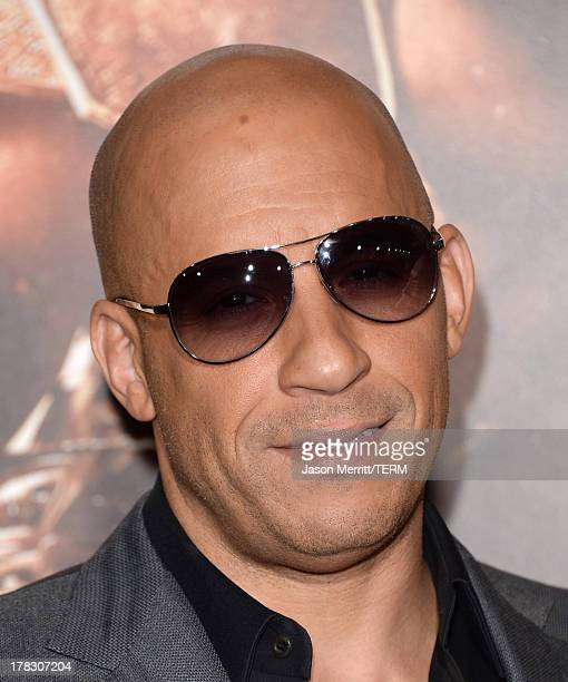 Actor/producer Vin Diesel arrives at the premiere of Universal Pictures' 'Riddick' at Mann Village Theatre on August 28 2013 in Westwood California