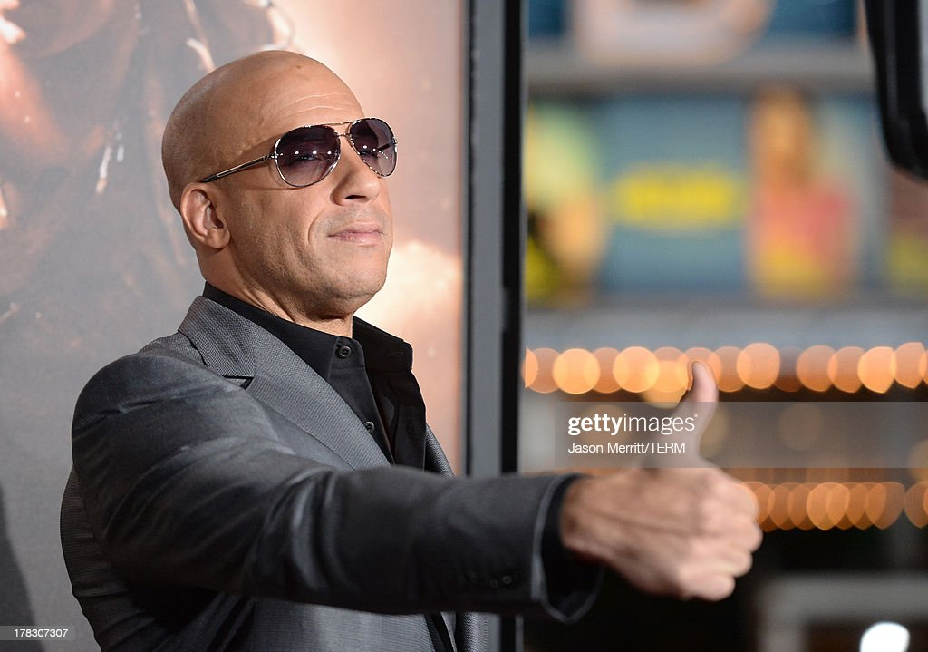 Actor/producer <a gi-track='captionPersonalityLinkClicked' href=/galleries/search?phrase=Vin+Diesel&family=editorial&specificpeople=171983 ng-click='$event.stopPropagation()'>Vin Diesel</a> arrives at the premiere of Universal Pictures' 'Riddick' at Mann Village Theatre on August 28, 2013 in Westwood, California.