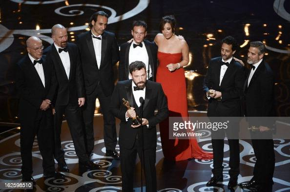 """Actor/producer/director Ben Affleck accepts the Best Picture award for """"Argo"""" onstage along with members of the cast and crew during the Oscars held..."""