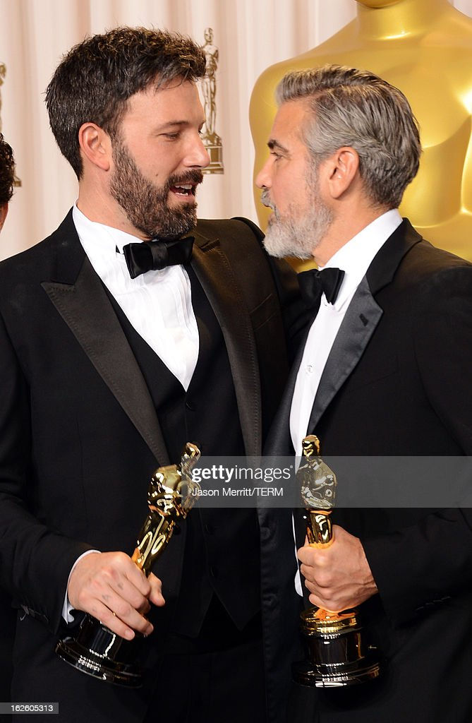 Actor-producer-director Ben Affleck (L) and producer George Clooney, winners of the Best Picture award for 'Argo,' pose in the press room during the Oscars held at Loews Hollywood Hotel on February 24, 2013 in Hollywood, California.