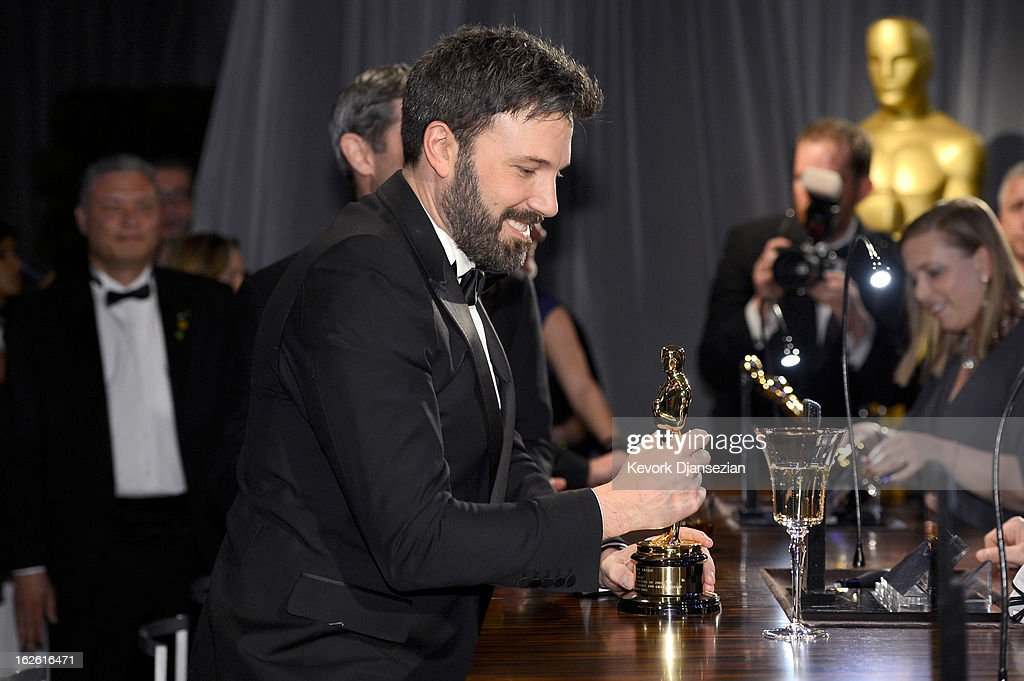Actor-producer-director Ben Affleck, winner of the Best Picture award for 'Argo,' gets his Oscar engraved at the Oscars Governors Ball at Hollywood & Highland Center on February 24, 2013 in Hollywood, California.