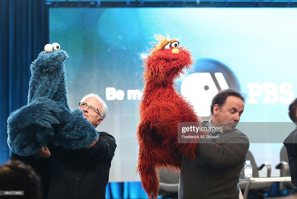 Actor/Puppeteer David Rudman and actor/puppeteer Joey Mazzrino speak onstage during the 'PBS Kids Update/Sesame Street 45th Season Anniversary' panel discussion at the PBS portion of the 2014 Winter Television Critics Association tour at Langham Hotel on January 21, 2014 in Pasadena, California.