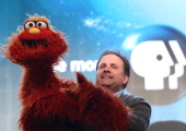 Actor/Puppeteer Joey Mazzarino speaks onstage during the 'PBS Kids Update/Sesame Street 45th Season Anniversary' panel discussion at the PBS portion...