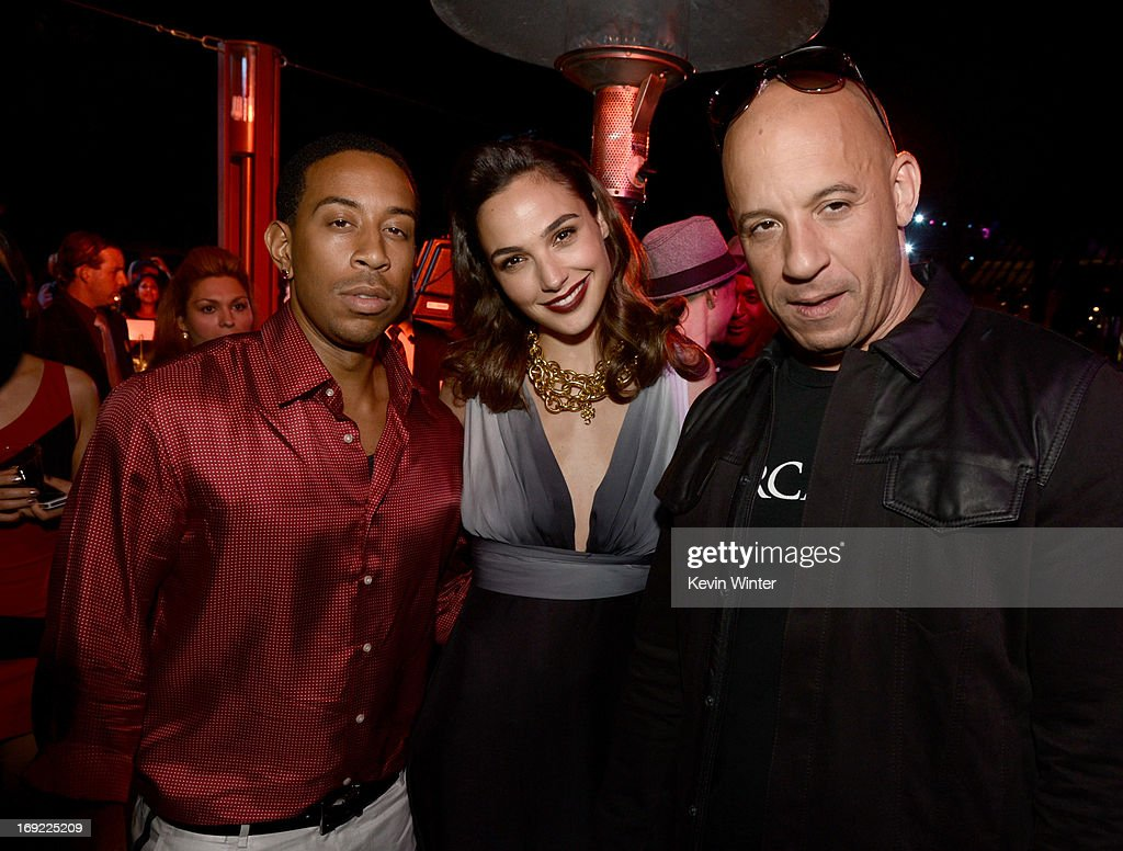 Actor/rapper Chris 'Ludacris' Bridges, actress Gal Gadot and actor/producer Vin Diesel pose at the after party for the premiere of Universal Pictures' 'Fast & Furious 6' at the Gibson Amphitheatre on May 21, 2013 in Universal City, California.