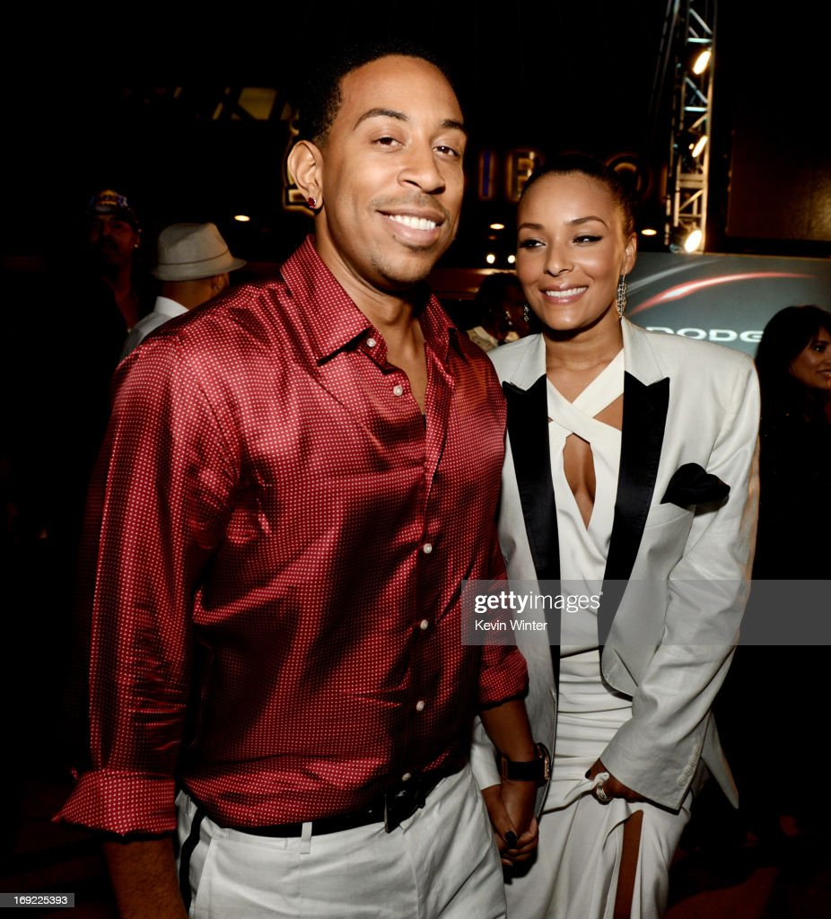 Actor/rapper Chris 'Ludacris' Bridges and his girlfriend Eudoxie arrive at the after party for the premiere of Universal Pictures' 'Fast & Furious 6' at the Gibson Amphitheatre on May 21, 2013 in Universal City, California.