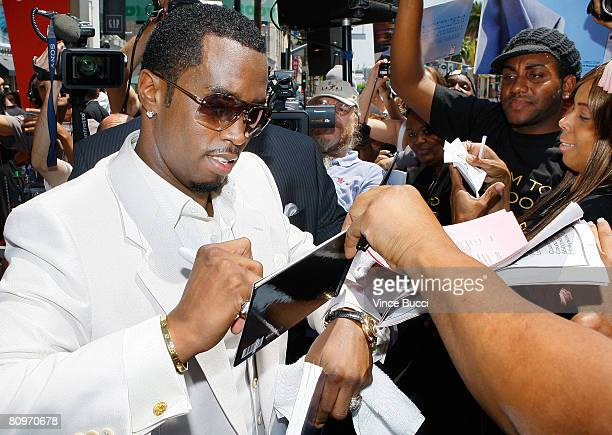 Actorrapper Sean 'Diddy' Combs signs autographs at the ceremony honoring him with a star on the Hollywood Walk of Fame on May 2 2008 on Hollywood...