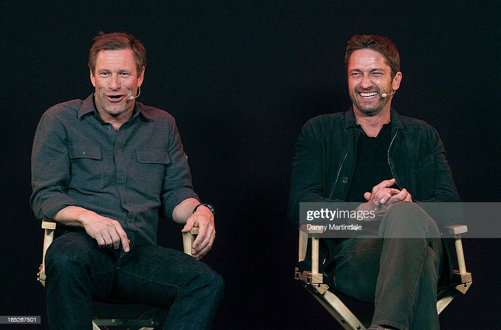 Actors (L-R) <a gi-track='captionPersonalityLinkClicked' href=/galleries/search?phrase=Aaron+Eckhart&family=editorial&specificpeople=220602 ng-click='$event.stopPropagation()'>Aaron Eckhart</a> and <a gi-track='captionPersonalityLinkClicked' href=/galleries/search?phrase=Gerard+Butler&family=editorial&specificpeople=202258 ng-click='$event.stopPropagation()'>Gerard Butler</a> attend the Meet The Filmmakers event ahead of tomorrow's UK Premiere of 'Olympus Has Fallen' at Apple Store, Regent Street on April 2, 2013 in London, England.