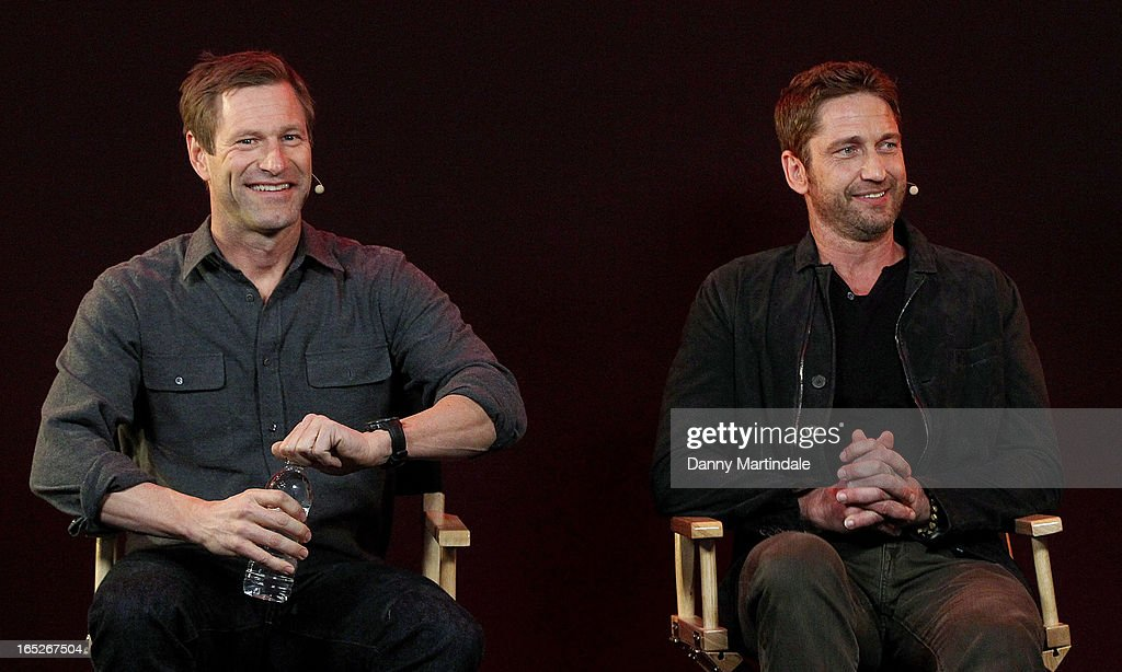Actors (L-R) Aaron Eckhart and Gerard Butler attend the Meet The Filmmakers event ahead of tomorrow's UK Premiere of 'Olympus Has Fallen' at Apple Store, Regent Street on April 2, 2013 in London, England.