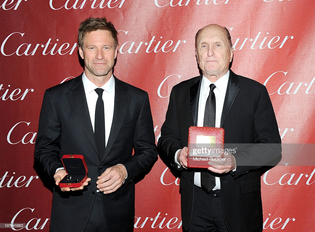 Actors <a gi-track='captionPersonalityLinkClicked' href=/galleries/search?phrase=Aaron+Eckhart&family=editorial&specificpeople=220602 ng-click='$event.stopPropagation()'>Aaron Eckhart</a> and <a gi-track='captionPersonalityLinkClicked' href=/galleries/search?phrase=Robert+Duvall&family=editorial&specificpeople=206637 ng-click='$event.stopPropagation()'>Robert Duvall</a> pose backstage at the 22nd Annual Palm Springs International Film Festival Awards Gala at the Palm Springs Convention Center on January 8, 2011 in Palm Springs, California.