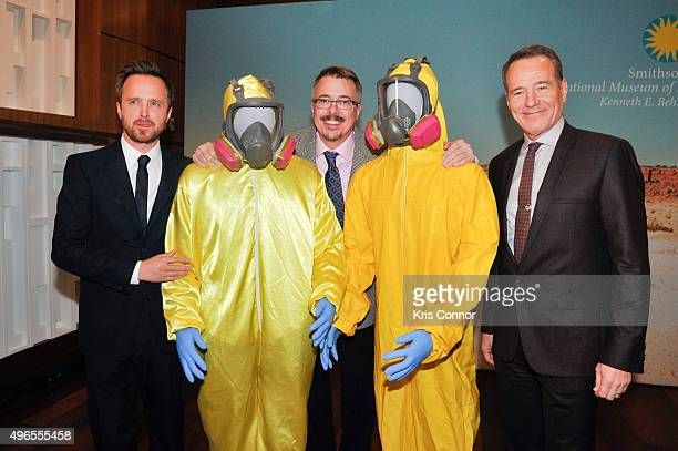 Actors Aaron Paul and Bryan Cranston with creator Vince Gilligan pose with their Tyvek suits during a donation ceremony of artifacts from AMC's...
