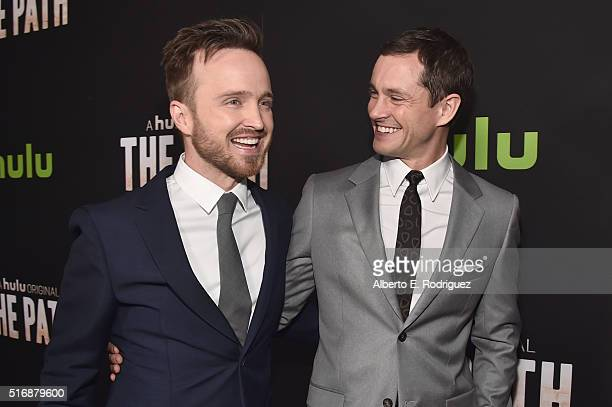 Actors Aaron Paul and Hugh Dancy arrive during the premiere of Hulu's 'The Path' at ArcLight Hollywood on March 21 2016 in Hollywood California