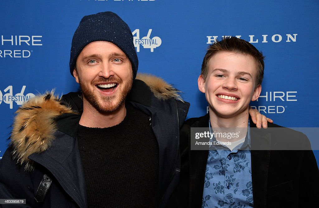 Actors Aaron Paul (L) and Josh Wiggins arrive at the 'Hellion' premiere party at Chase Sapphire on January 17, 2014 in Park City, Utah.
