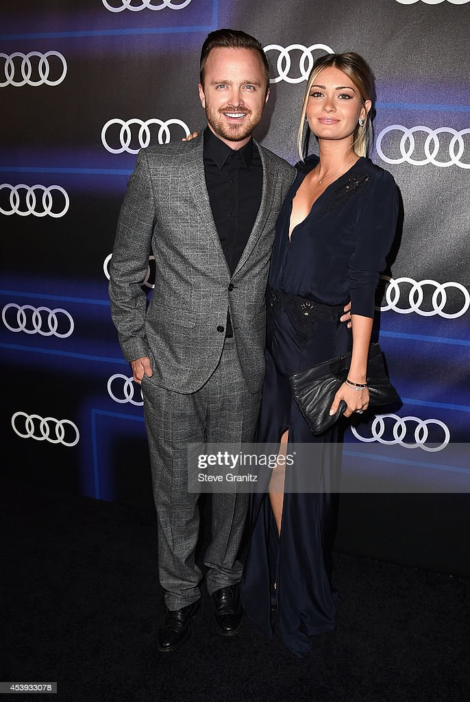 Actors Aaron Paul and Lauren Parsekian attend Audi Emmy Week Celebration at Cecconi's Restaurant on August 21 2014 in Los Angeles California