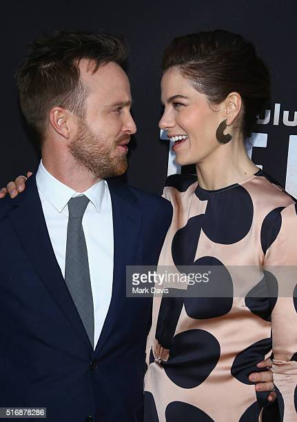 Actors Aaron Paul and Michelle Monaghan arrive during the premiere of Hulu's 'The Path' at ArcLight Hollywood on March 21 2016 in Hollywood California