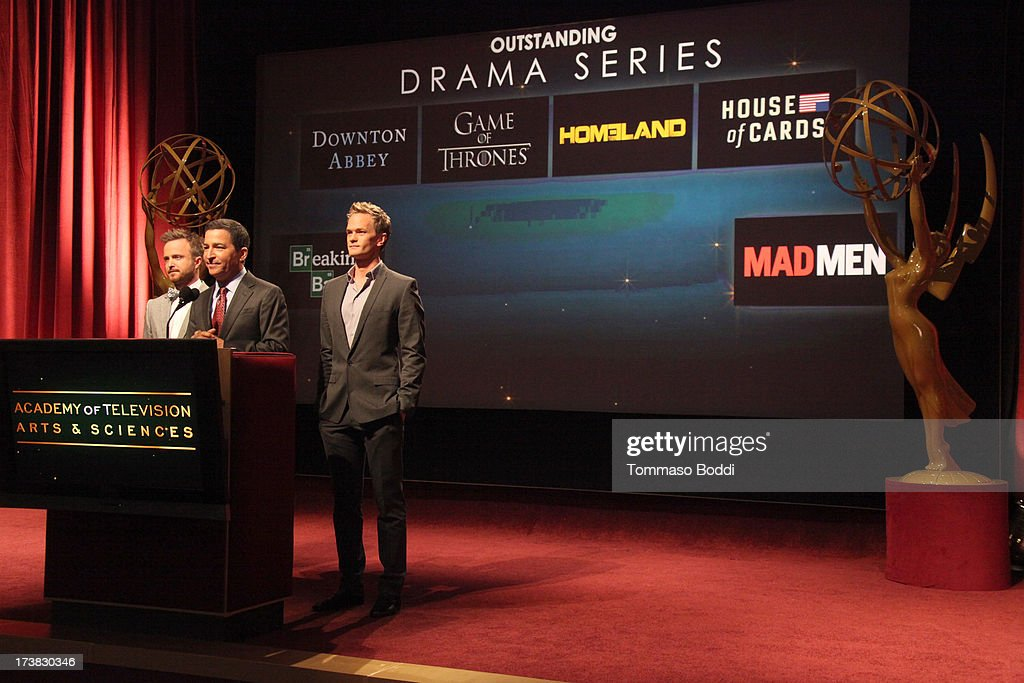 Actors Aaron Paul (L) and Neil Patrick Harris (R), and Academy of Television Arts & Sciences Chairman & CEO Bruce Rosenblum (C) announce the nominees for the Outstanding Drama Series Award during the 65th Primetime Emmy Awards nominations at the Television Academy's Leonard H. Goldenson Theatre on July 18, 2013 in North Hollywood, California.