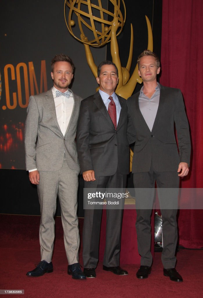 Actors <a gi-track='captionPersonalityLinkClicked' href=/galleries/search?phrase=Aaron+Paul+-+Actor&family=editorial&specificpeople=693211 ng-click='$event.stopPropagation()'>Aaron Paul</a> (L) and <a gi-track='captionPersonalityLinkClicked' href=/galleries/search?phrase=Neil+Patrick+Harris&family=editorial&specificpeople=210509 ng-click='$event.stopPropagation()'>Neil Patrick Harris</a> (R), and Academy of Television Arts & Sciences Chairman & CEO Bruce Rosenblum (C) pose onstage during the 65th Primetime Emmy Awards nominations at the Television Academy's Leonard H. Goldenson Theatre on July 18, 2013 in North Hollywood, California.
