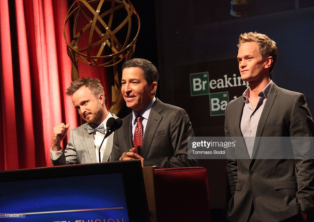 Actors Aaron Paul (L) and Neil Patrick Harris (R), and Academy of Television Arts & Sciences Chairman & CEO Bruce Rosenblum (C) speak onstage during the 65th Primetime Emmy Awards nominations at the Television Academy's Leonard H. Goldenson Theatre on July 18, 2013 in North Hollywood, California.