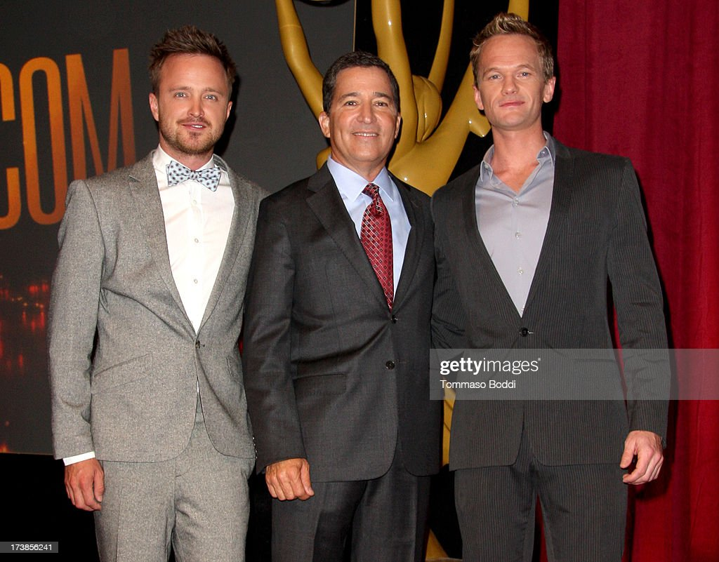 Actors Aaron Paul (L) and Neil Patrick Harris (R), and Academy of Television Arts & Sciences Chairman & CEO Bruce Rosenblum (C) pose onstage during the 65th Primetime Emmy Awards nominations at the Television Academy's Leonard H. Goldenson Theatre on July 18, 2013 in North Hollywood, California.