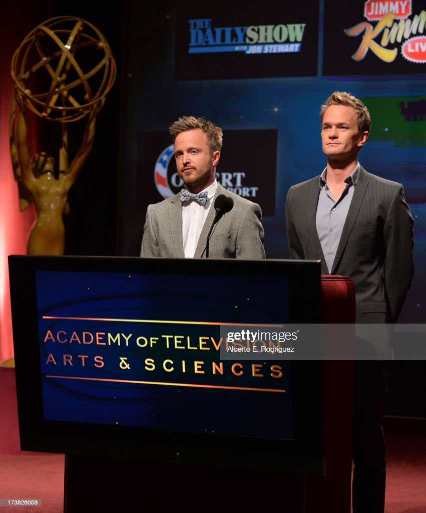 Actors <a gi-track='captionPersonalityLinkClicked' href=/galleries/search?phrase=Aaron+Paul+-+Actor&family=editorial&specificpeople=693211 ng-click='$event.stopPropagation()'>Aaron Paul</a> (L) and <a gi-track='captionPersonalityLinkClicked' href=/galleries/search?phrase=Neil+Patrick+Harris&family=editorial&specificpeople=210509 ng-click='$event.stopPropagation()'>Neil Patrick Harris</a> announce the nominees for the Outstanding Variety, Music, or Comedy Special Award during the 65th Primetime Emmy Awards nominations at the Television Academy's Leonard H. Goldenson Theatre on July 18, 2013 in North Hollywood, California.