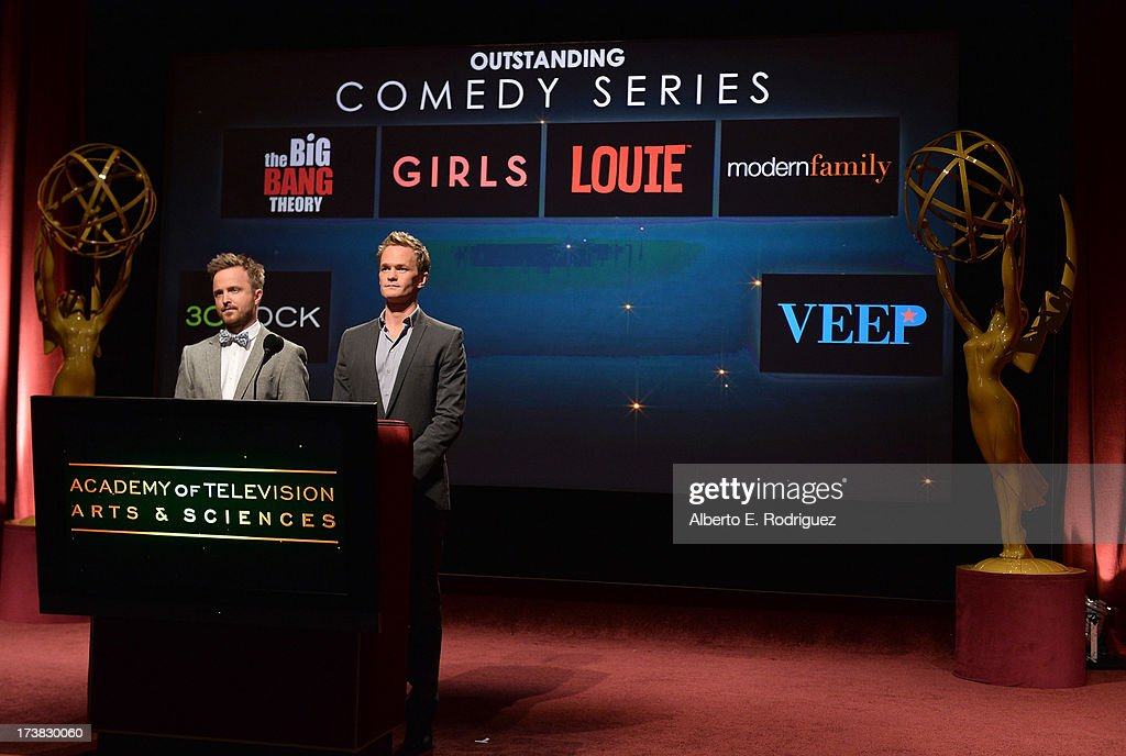 Actors Aaron Paul (L) and Neil Patrick Harris announce the nominees for the Outstanding Comedy Series Award during the 65th Primetime Emmy Awards nominations at the Television Academy's Leonard H. Goldenson Theatre on July 18, 2013 in North Hollywood, California.