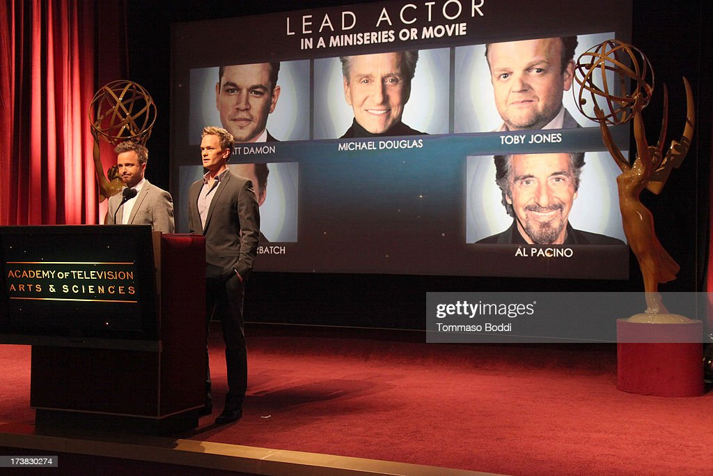 Actors Aaron Paul (L) and Neil Patrick Harris announce the nominees for the Outstanding Lead Actor in a Miniseries or Movie Award during the 65th Primetime Emmy Awards nominations at the Television Academy's Leonard H. Goldenson Theatre on July 18, 2013 in North Hollywood, California.