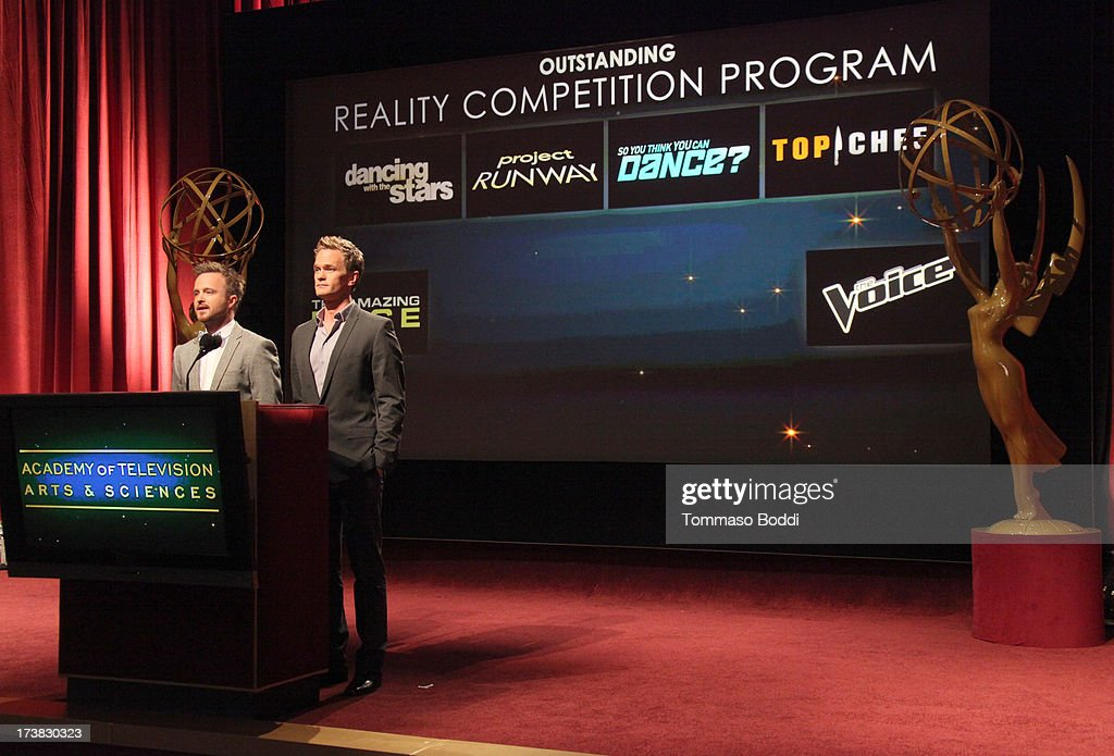 Actors Aaron Paul (L) and Neil Patrick Harris announce the nominees for the Outstanding Reality-Competition Program Award during the 65th Primetime Emmy Awards nominations at the Television Academy's Leonard H. Goldenson Theatre on July 18, 2013 in North Hollywood, California.