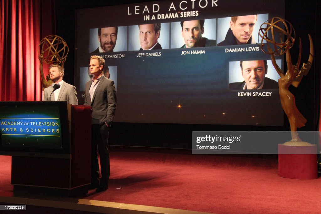 Actors Aaron Paul (L) and Neil Patrick Harris announce the nominees for the Outstanding Lead Actor in a Drama Series Award during the 65th Primetime Emmy Awards nominations at the Television Academy's Leonard H. Goldenson Theatre on July 18, 2013 in North Hollywood, California.