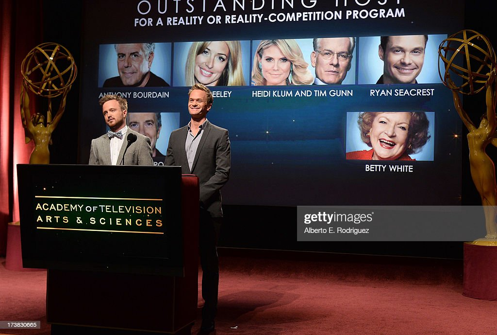 Actors Aaron Paul (L) and Neil Patrick Harris announce the nominees for the Outstanding Host for a Reality or Reality-Competition Program Award during the 65th Primetime Emmy Awards nominations at the Television Academy's Leonard H. Goldenson Theatre on July 18, 2013 in North Hollywood, California.